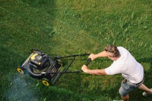 Man mowing lawn during isolation